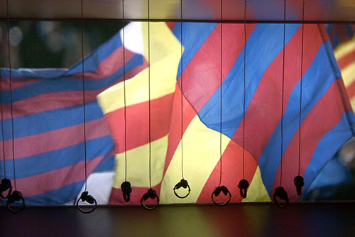 Camp Nou Experience : Headsets with FC Barcelona and Catalan flags in background